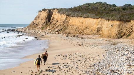 Surfers hunt Long Island waves near Camp Hero