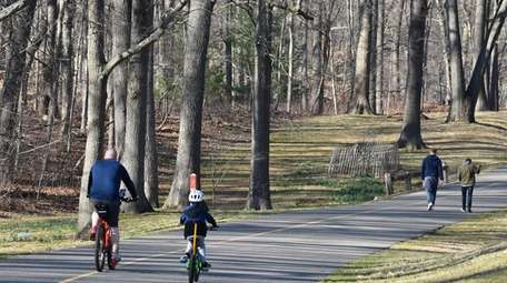 Bikers and walkers share the paved paths that