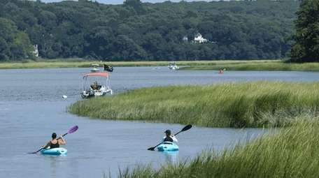 Kayakers head out of Nissequogue River State Park