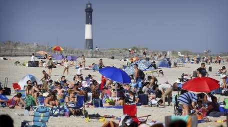Crowds gather at the beach at Robert Moses