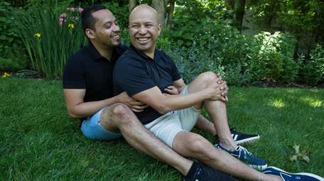 Ernesto Hernandez, right, assistant program manager of HIV