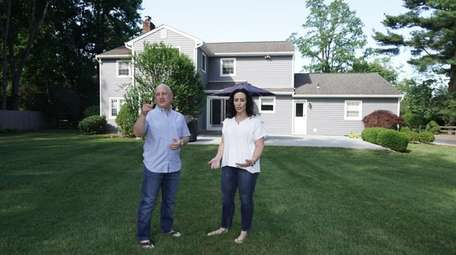 Randi and Michael Jaffe in the backyard of