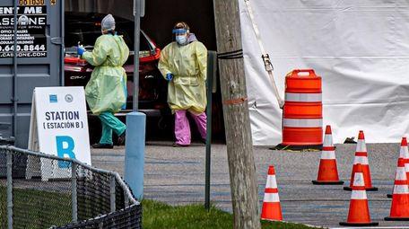 Medical personnel preparing for COVID-19 testing at Huntington