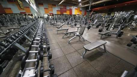 The weight room remains empty at Gold's Gym