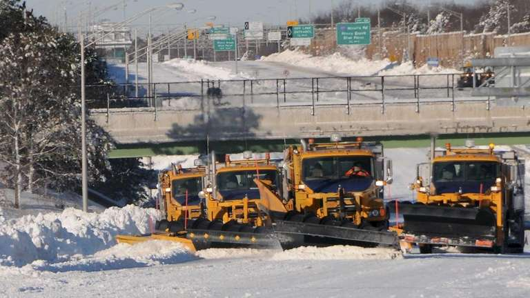 Snowplows clear eastbound lanes of the Long Island