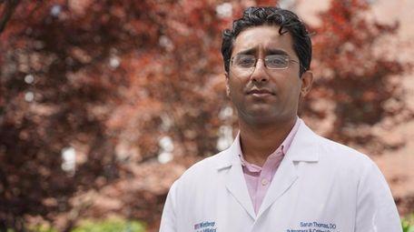 Dr. Sarun Thomas, director of the medical ICU