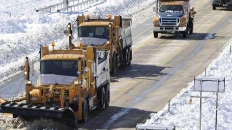 New York State Department of Transportation trucks clearing