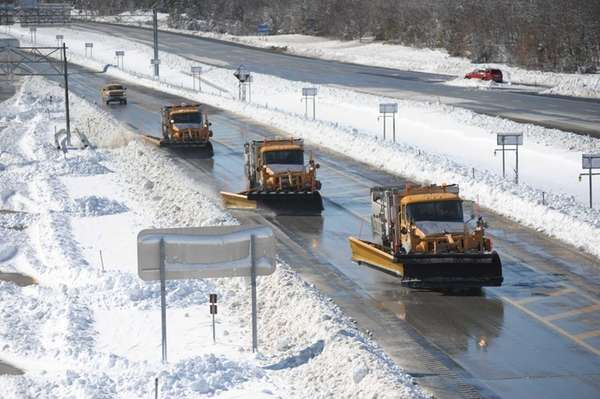 New York State Department of Transportation trucks clear