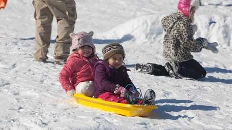Sisters Andrea, 5, and Emma Cordulack, 3, of