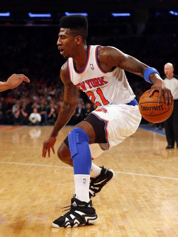 Iman Shumpert controls the ball during a game