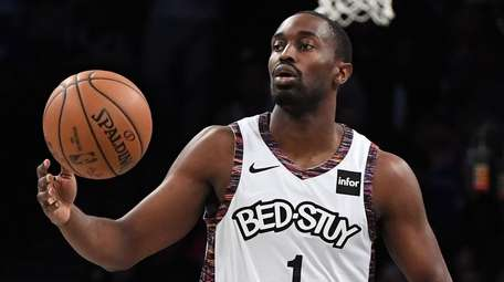 Then-Nets guard Theo Pinson brings the ball upcourt