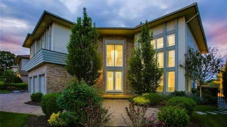Priced at $3,200,000, this Contemporary home with six