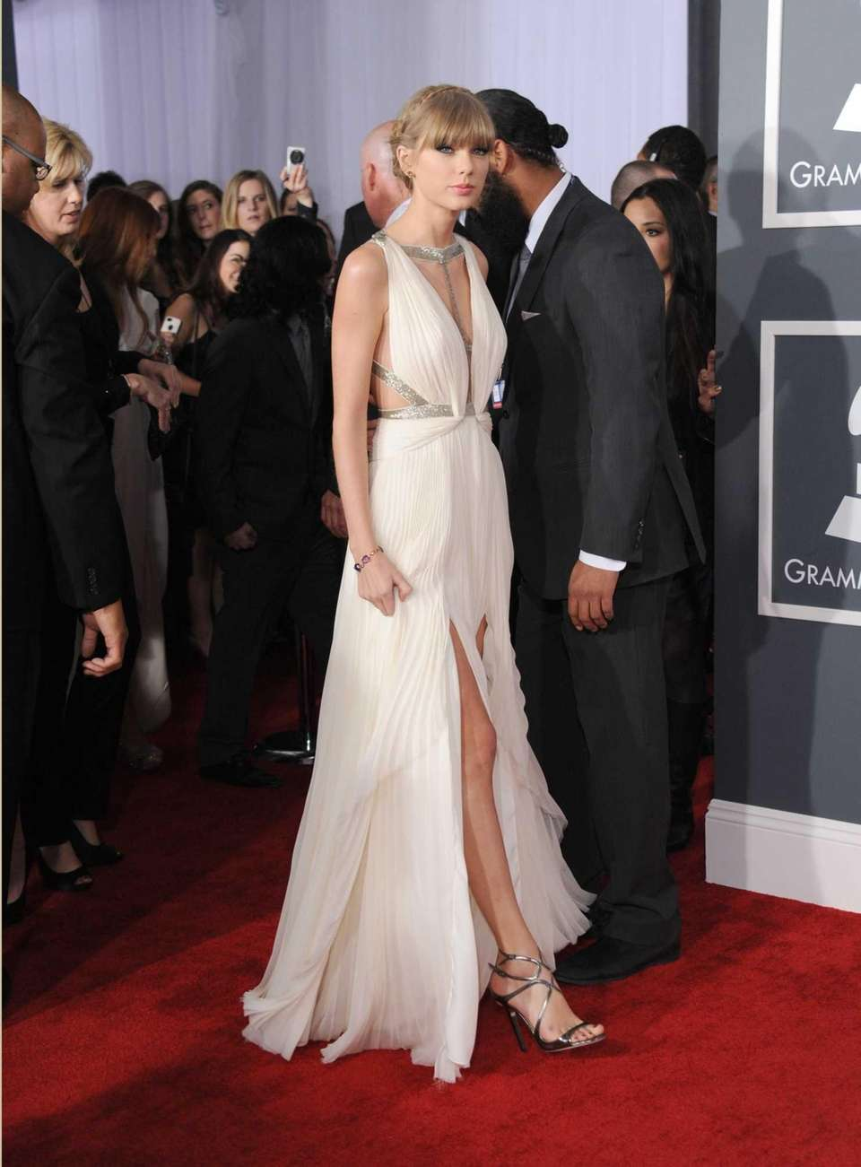 Taylor Swift arrives at the 55th Grammy Awards