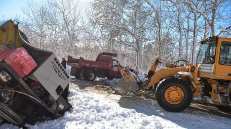 Town of Brookhaven highway workers clean up the