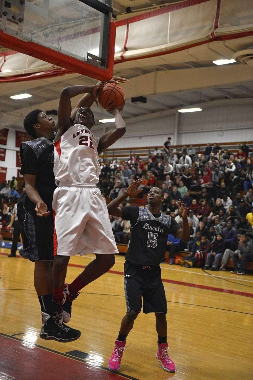Lutheran forward/center Kentan Facey goes up for a