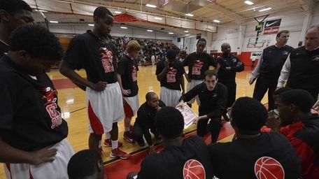 Lutheran coach John Buck talks to his team