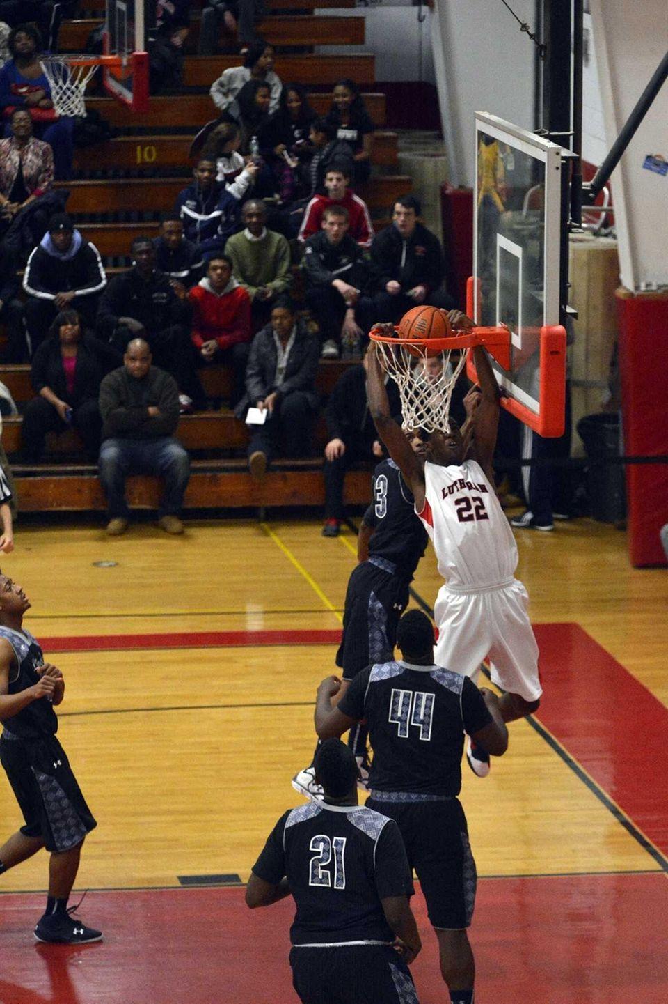 Lutheran forward/center Kentan Facey slam dunks the ball