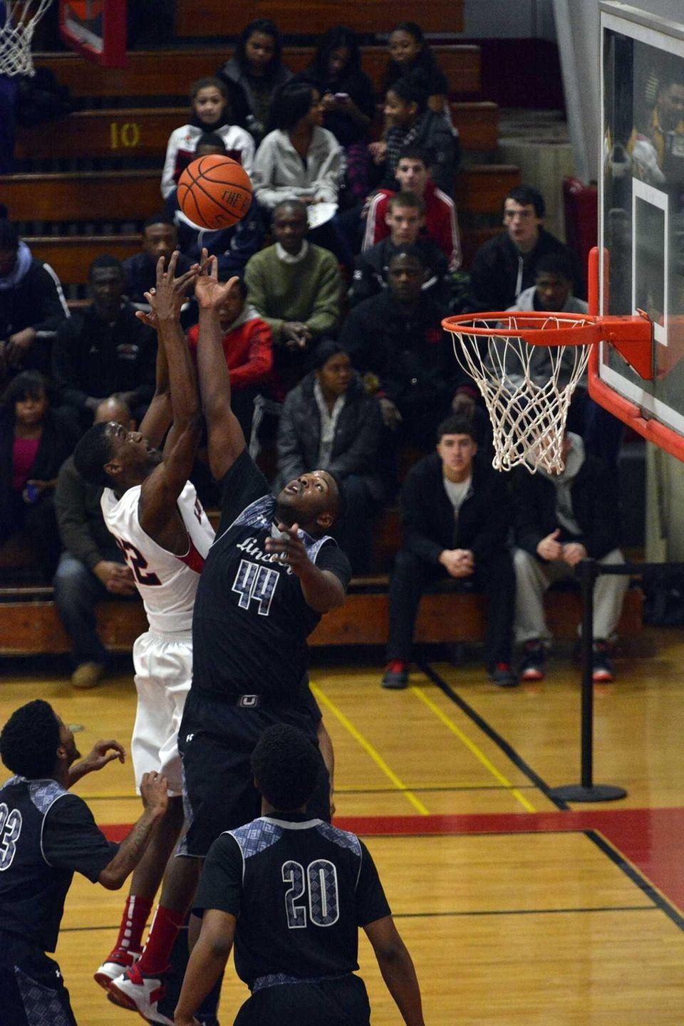 Lutheran center/forward Kentan Facey battles for a rebound