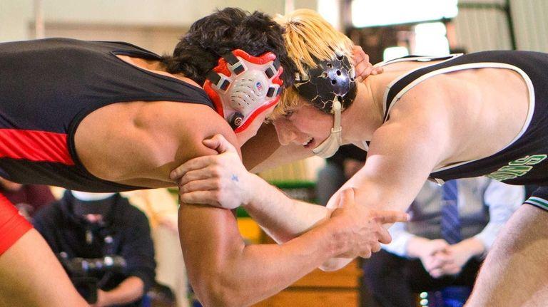Locust Valley's Sam Ward, right, beat Wheatley's Erik