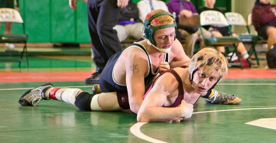 Locust Valley's Mike Dusold, left, beat Clarke's Joe