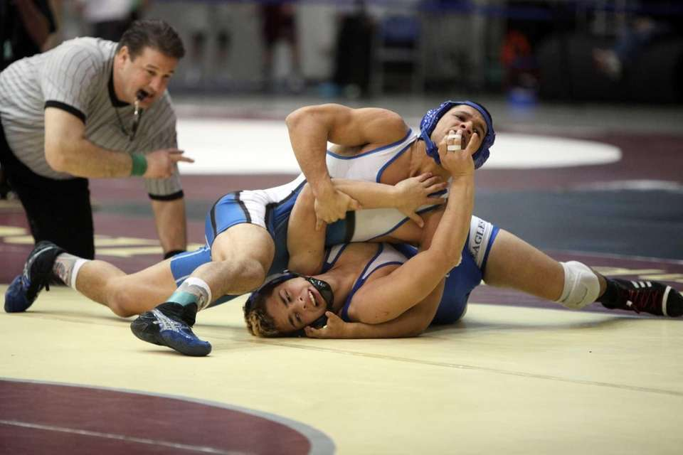 Calhoun's Julian Arroyo, top, wrestles Valley Stream Central's