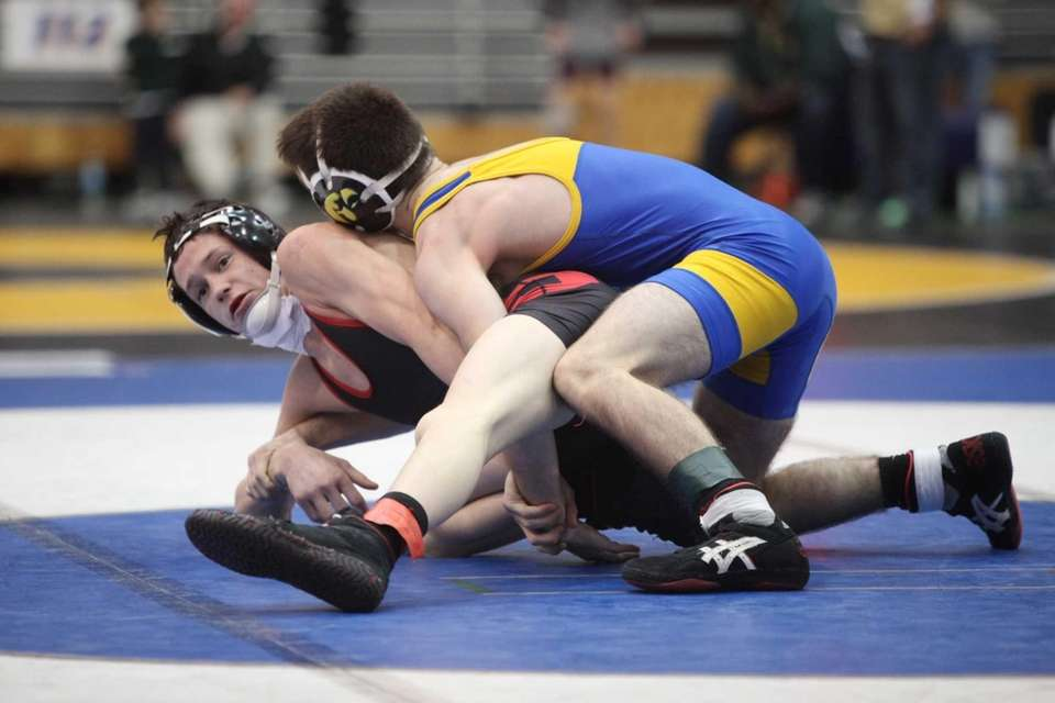 Syosset's Nick Rondino, left, wrestles East Meadow's Adam
