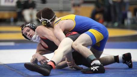 Syosset's Nick Rondino, left, wrestles East Meadow's Adam