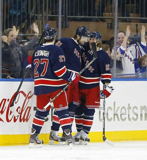 Carl Hagelin celebrates his first-period goal with Rick