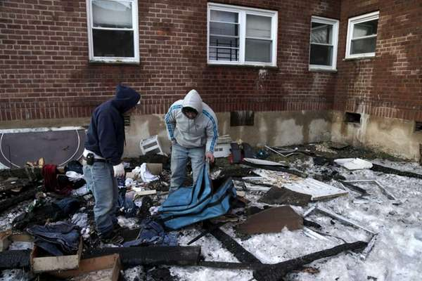 Residents of an apartment damaged during a fire