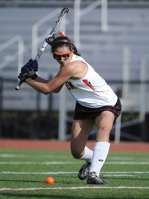 Sachem East's Katie Trombetta passes the ball during