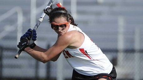 Sachem East's Katie Trombetta passes the ball during