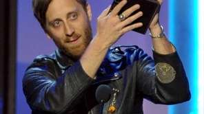 Dan Auerbach accepts the award for producer of