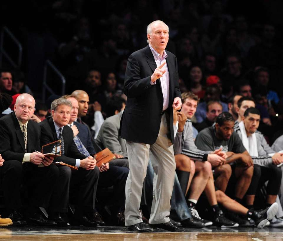 San Antonio Spurs head coach Greg Popovich looks