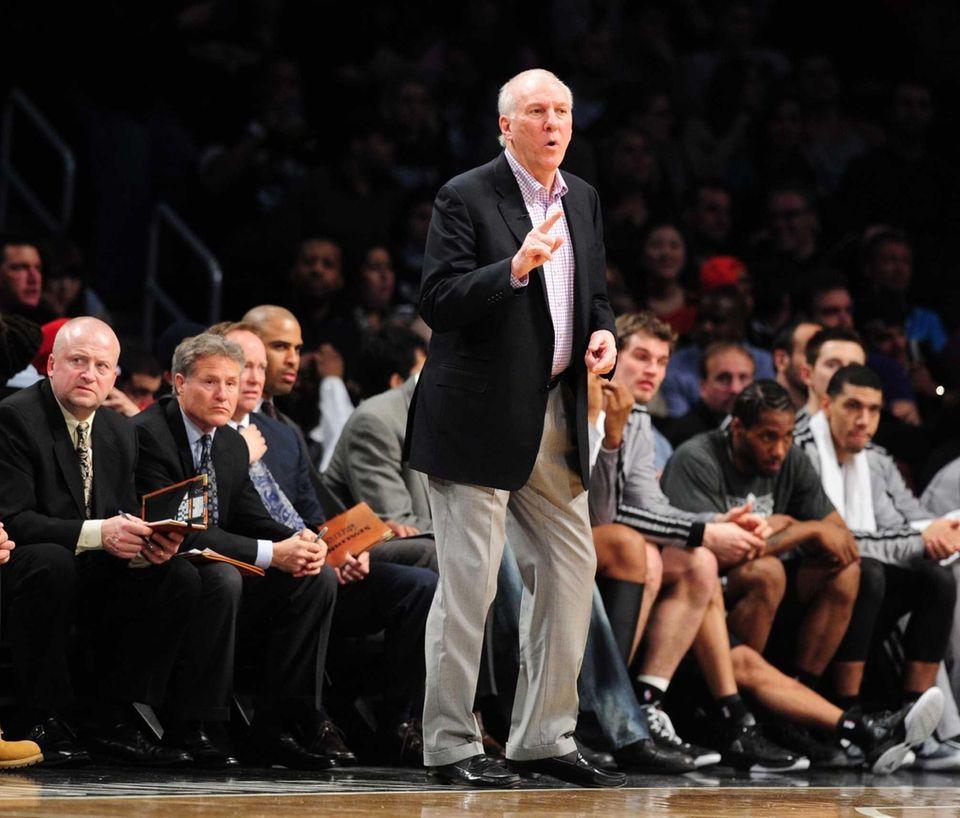 San Antonio Spurs head coach Greg Popovich looks