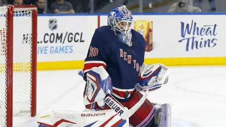 Henrik Lundqvist makes a save during a game