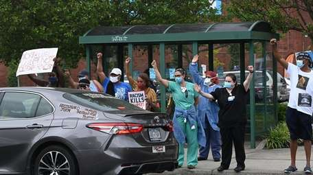 Health care workers protest outside Southside Hospital in