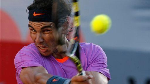 Rafael Nadal returns the ball to Horacio Zeballos
