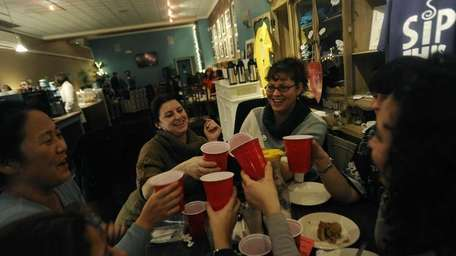 Friends toast at a women's night together at