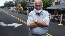 Patchogue Mayor Paul Pontieri stands on a closed-off