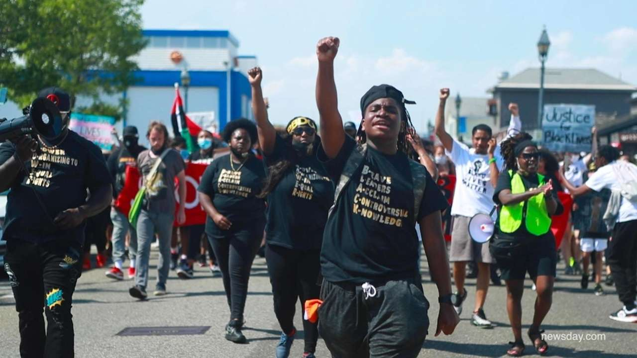 Protesters marched toward the Nautical Mile on Sunday,