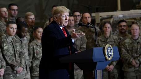 President Donald Trump with U.S. troops on Thanksgiving