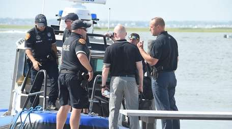 Suffolk County police and detectives investigate a boating