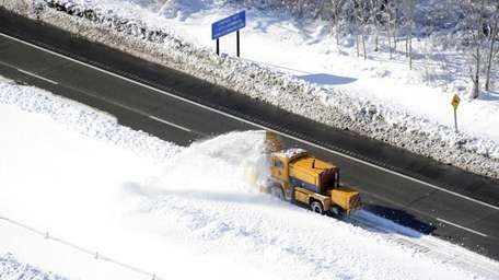 Snow is plowed on the LIE between exits