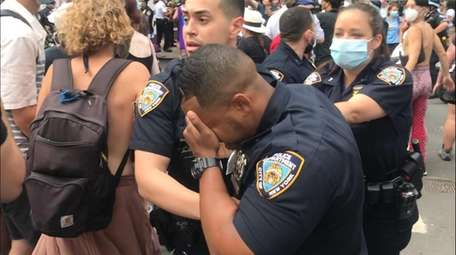 A cop at an LGBTQ Pride march writhes
