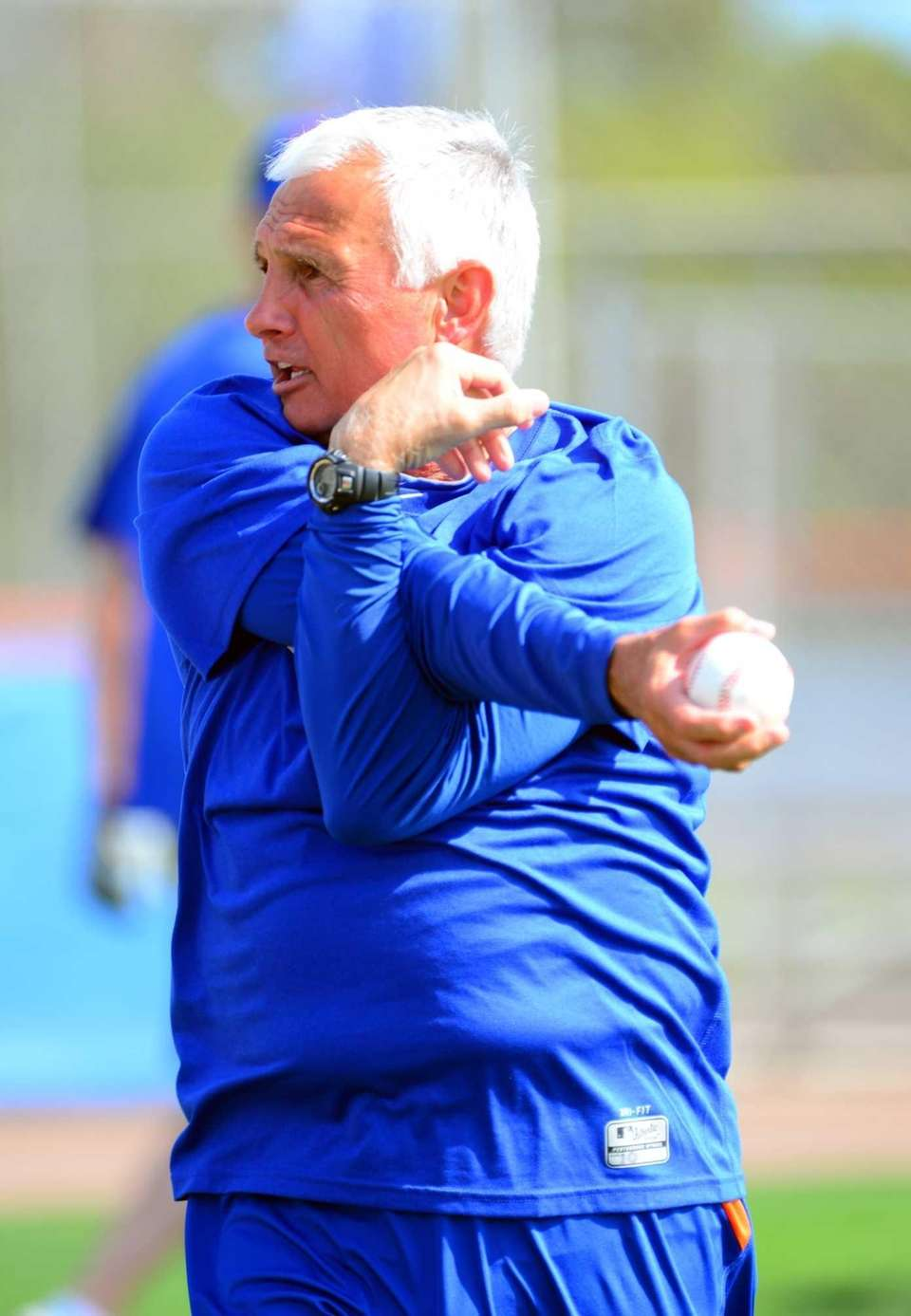 Mets manager Terry Collins stretches during spring training.