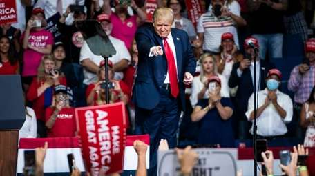 President Donald Trump arrives at a rally at