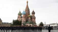 Kremlin guards perform in Red Square with the