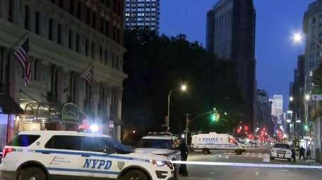 NYPD vehicles at the scene Friday of a