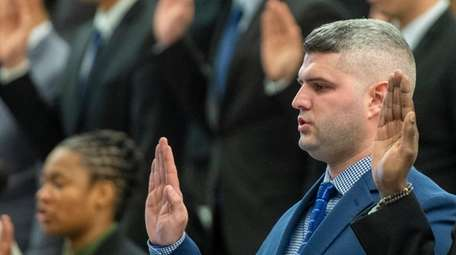 Michael Alvarez at the swearing-in ceremony for recruits