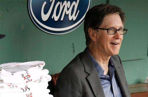 Boston Red Sox owner John Henry sits in